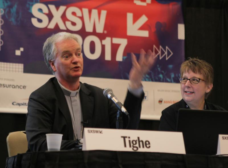 Irish Bishop Paul Tighe, adjunct secretary of the Pontifical Council for Culture, speaks March 10 during the South by Southwest Festival in Austin, Texas. At right is Helen Osman, a communication adviser. (CNS photo/Matt Palmer)